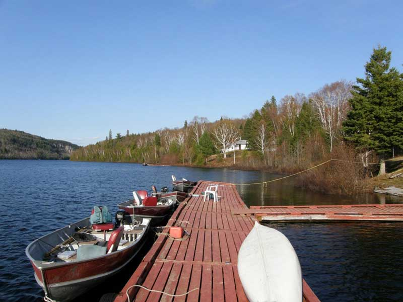 boats ready to take out for a day of trout fishing Blue Lake Camp - fishing lodge on Kirkpatrick Lake