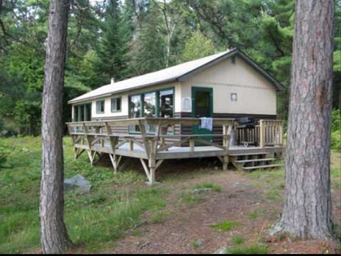 Blue Lake Camp - trout fishing lodge on Kirkpatrick Lake wrap around deck on your cabin