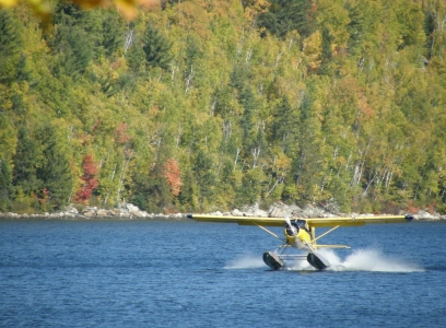 Beaver floatplane landing at camp